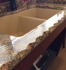 granite countertop black painted cabinets tumbled marble