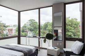 press archives dc condo sales and marketing real estate the master bedroom has floor to ceiling windows that wrap around a corner of the room benjamin c tankersley for the washington post