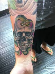 Snake Forearm - skull and snake on forearm by ami