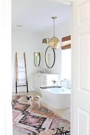Master Bathroom With Pink Rug And Black Dip Dyed Towel Ladder