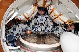 photo cramming a crew inside a soyuz spacecraft on orbit spaceref