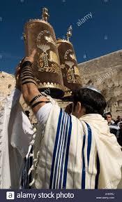 prayer shawls from israel orthodox wrapped with talit prayer shawl holding torah