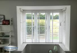 white wooden blinds with tapes in a box bay window wooden blinds white wooden blinds with tapes in a box bay window harmony blinds of bolton and chorley