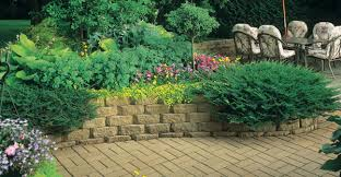 How To Landscape A Sloped Backyard - build a retaining wall with landscape blocks garden club