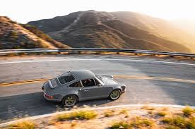 old hatchback porsche driving the 1990 porsche 911 reimagined by singer vehicle design
