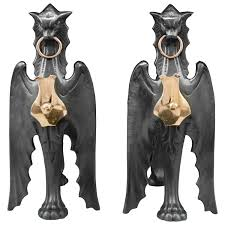 pair of antique cast iron and copper mounted griffin andirons for