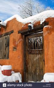 wooden door on adobe style home in winter in santa fe new mexico