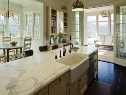 marble countertop and apron sink in classy farmhouse kitchen feat