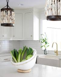 seashell light pendants over island transitional kitchen