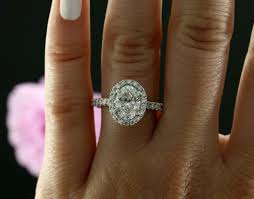 yellow gold oval engagement rings 9x7mm oval forever brilliant moissanite and halo