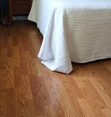 Best Way To Clean White Walls by Grey Wooden Laminate Flooring With White Island And Chairs Also