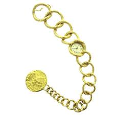 piaget bracelet an early 70 s salvador dali yellow gold bracelet with coin
