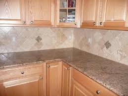 honey oak cabinets with verde butterfly countertops backsplash is
