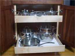 kitchen cabinet drawer peg organizer pot and pan organization that will work for any kitchen