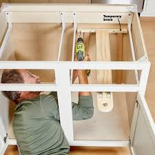 kitchen cabinet storage solutions diy pot and pan pullout kitchen cabinet storage solutions diy pot and pan pullout