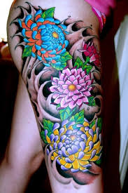 Leg Flower - coloured flowers on leg tattooimages biz