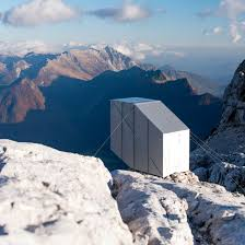 cantilevering alpine shelter by ofis offers shelter to slovenian