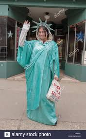 woman female dressed as statue of liberty advertising liberty tax