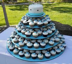 Cupcake Wedding Cake 5 Tier Wedding Cake And Chocolate Buttercream Cupcakes With Blue