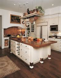 modern traditional kitchen with a shiny copper backsplash that