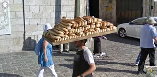 google street view captures a guy in israel carrying a huge pile