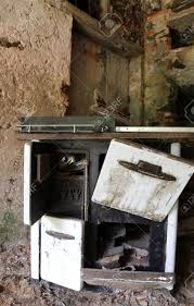 ancient wood burning stove of old kitchen in an old abandoned