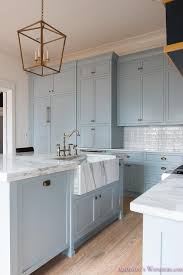 Farm Sink With Backsplash by Blue Center Island With Marble Farmhouse Sink Transitional Kitchen
