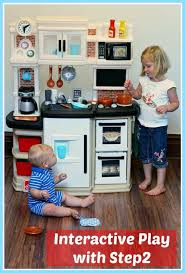 Step Two Play Kitchen by Interactive Play With The Step2 Great Gourmet Kitchen Set Plus A