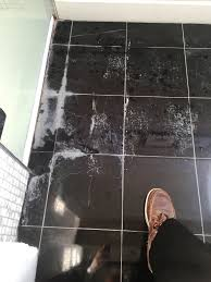 removing limescale from polished black marble floor tiles in a