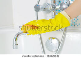 Cleaning Bathroom Faucets by Woman Doing Chores Bathroom Cleaning Sink Stock Photo 269263529