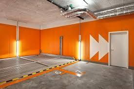 Endearing Garage Design With Clement Flooring Tile And Orange Wall