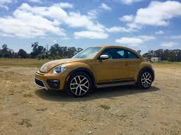 review vw u0027s beetle dune 100 gold volkswagen beetle see new volkswagens today