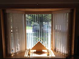 free hanging fabric vertical in bay window with split draw center