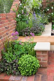 sitting next to fragrant herbs and flowers garden bench sage