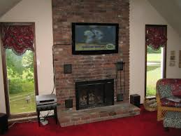 installing wall mount tv furniture entertainment room with brick fireplace under wall