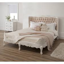 white wooden bed frame with carving ornaments also leather