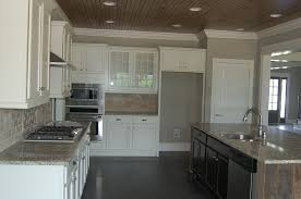 classic kitchen with white cabinets barnwood hexagon backsplash