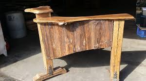 Black Salon Reception Desk Black Walnut Wood Slab With Barn Siding For A Reception Desk In A