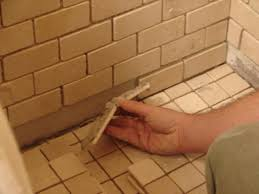 Installing Ceramic Wall Tile How To Install Tile In A Bathroom Shower How Tos Diy
