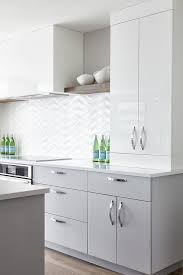 gloss white kitchen cabinets glossy white cabinets and gray flat front lower
