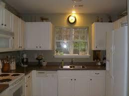 should i put pulls or knobs on kitchen cabinets knobs on false fronts