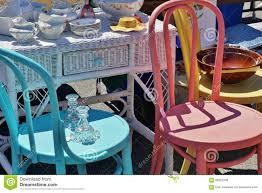 street fail garage sale vintage antique dishes on wicker desk next
