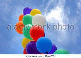 balloons that float and white party balloons float up into the blue sky stock