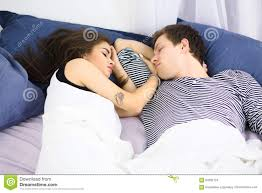 couple in bed with sex and affection royalty free stock photos couple sleeping on bed stock images
