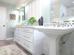 white cabinet bathroom laundry room combination on the wooden