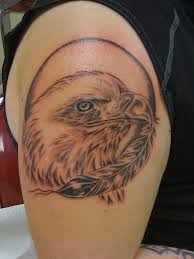 bald eagle with cross tattoo on upper arm photos pictures and