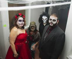 couple with love of halloween picks haunted house in western