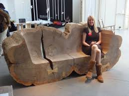 tree trunk benches made from recovered elms pop up in