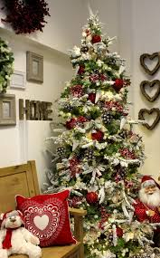Snow Flocking For Christmas Trees by A Red White And Natural Theme On A Snow Flocked Christmas Tree