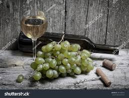 wine bottle grapes glass wine stock photo 301340843 shutterstock